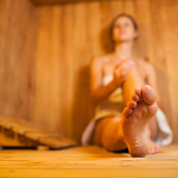 Sauna visits will increase your body's ability to detoxify all the excess. Stock Image