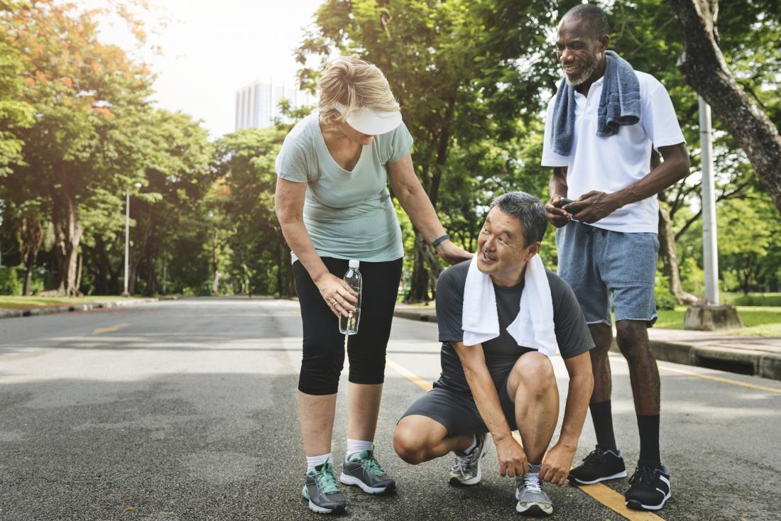 seniors exercising in a park