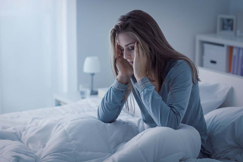 PMS-symptoms-Natural-remedies-will-help-Woman-with-insomnia