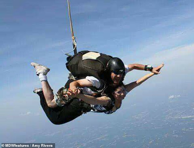 Freedom: Amy even took to the skies for a sky-diving session before her leg procedure