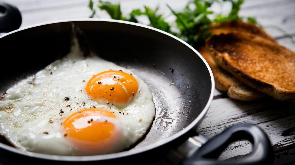 2 fried eggs in pan