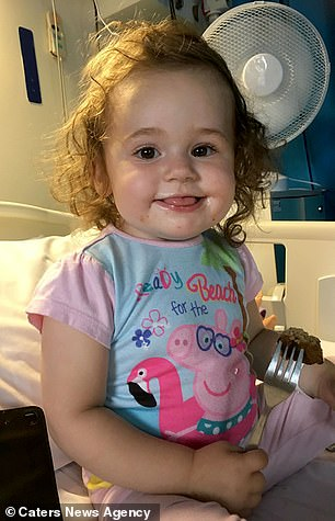 She is pictured shortly after doctors discovered the youngster was battling a tumour