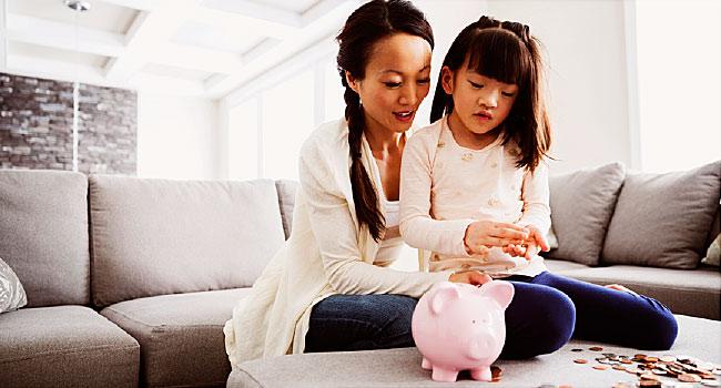 mother teaches daughter saving