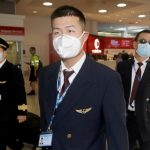 China confirms 1st death outside epicenter of viral outbreak