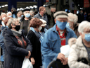 People wait in line at the Olympic Stadium in Montreal in early March for their COVID-19 jab as Quebec began vaccinations for seniors.